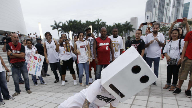 AMiami Heat fan dances in front of the American Airlines Arena before Game 5 of the NBA finals basketball series against the Oklahoma City Thunder, Thursday, June 21, 2012, in Miami. (AP Photo/Lynne Sladky)