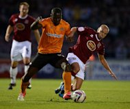 Frank Nouble, centre, got Wolves' second goal at Sixfields