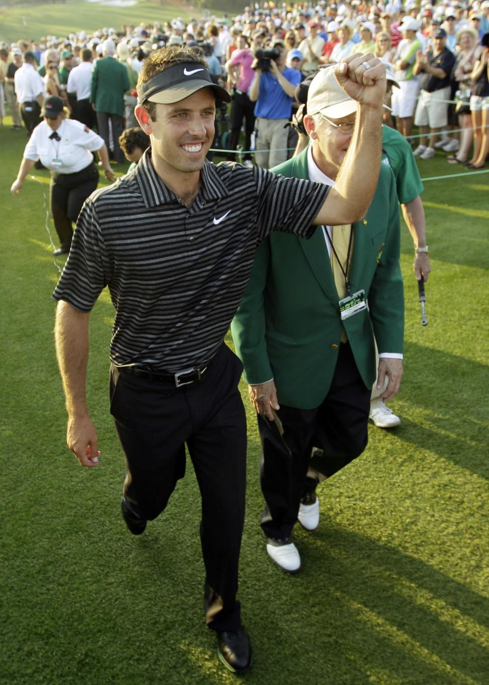 Charl Schwartzel of South Africa celebrates after finishing the final round of the Masters golf tournament Sunday, April 10, 2011, in Augusta, Ga. (AP Photo/Dave Martin)