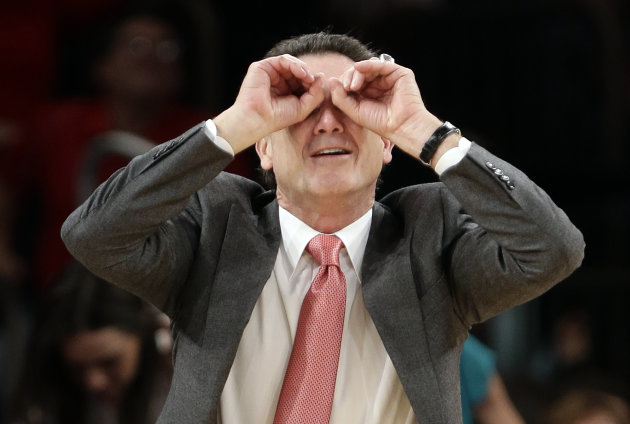 This photo taken March 15, 2013, shows Louisville head coach Rick Pitino gesturing to his team during the second half of an NCAA college basketball game against the Notre Dame at the Big East Conference tournament in New York. The Cardinals have shown that theyre comfortable being front-runners in their season-long quest to go further than last years Final Four appearance. Now, they enter the NCAA tournament as the overall No 1 seed. (AP Photo/Frank Franklin II)