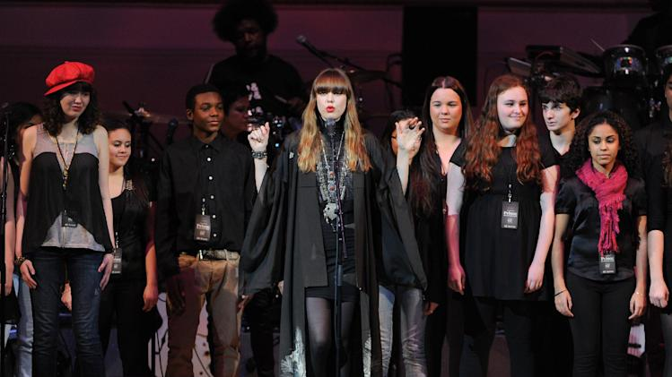 "Singer Diane Birch, center, and a choir perform at ""The Music of Prince"" tribute concert at Carnegie Hall on Thursday March 7, 2013 in New York. (Photo by Evan Agostini/Invision/AP)"