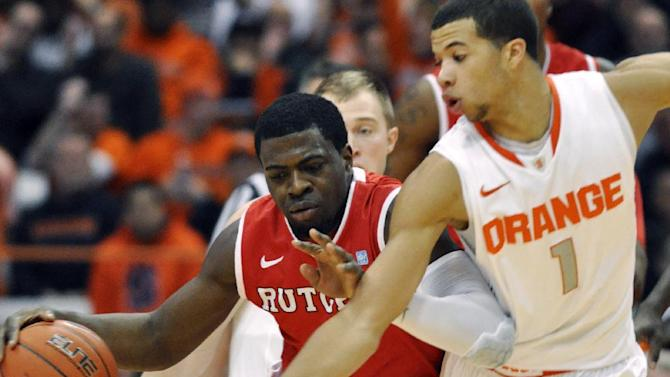 Rutgers' Eli Carter, left, dribbles past Syracuse's Michael Carter-Williams during the second half of an NCAA college basketball game in Syracuse, N.Y., Wednesday, Jan. 2, 2013. Syracuse won 78-53. (AP Photo/Kevin Rivoli)