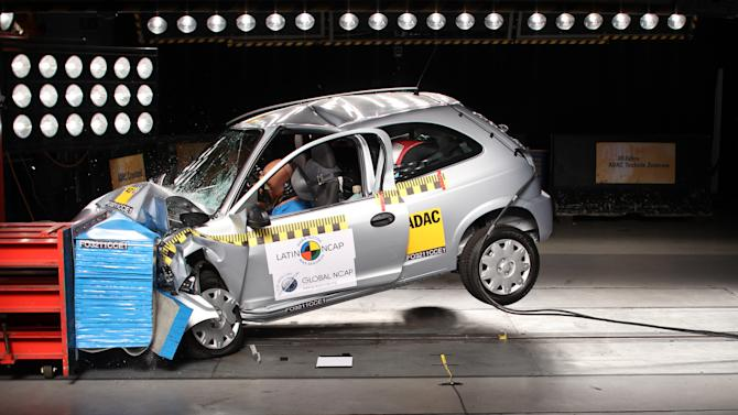 This 2011 photo released by Proteste, a consumer defense group, shows a crash test on a Chevrolet Celta vehicle in Brazil. The Celta is Brazil's No. 5 car in terms of sales, with 137,615 sold in 2012, but it received the low safety rating of one star after its door unhinged and the passenger cabin roof bent into an inverted V shape during its crash test. (AP Photo/Proteste)
