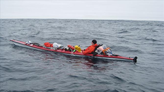 """This Tuesday, June 10, 2014 image provided by the U.S. Coast Guard shows the moments before a rescue of a kayaker about 60 miles southwest of Santa Barbara's Point Conception near southern California. The U.S. Coast Guard says a man is """"lucky to be alive"""" after he was rescued 11 days into an attempted kayak voyage from California to Hawaii. A helicopter spotted the 57-year-old man, who had turned back to California after he sent a distress call indicating equipment failure, the Coast Guard said in a statement. (AP photo/U.S. Coasst Guard)"""