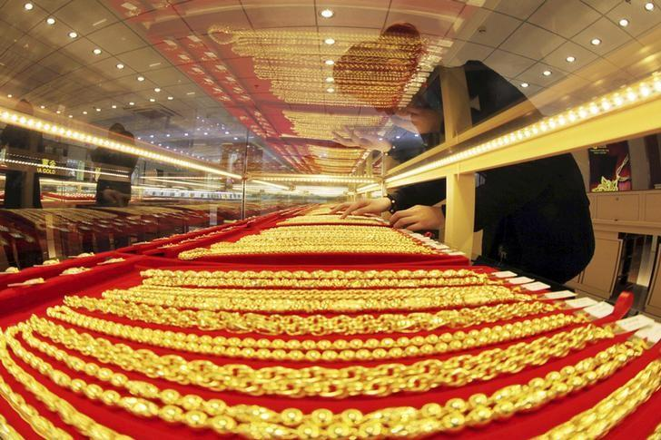 Gold rises after slide, eyes best month in nearly a year