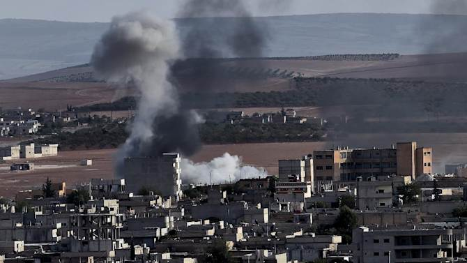 Smoke rises after an airstrike on Syria's  Kobane, October 9, 2014. A US-Turkish team will meet to discuss the fight against IS