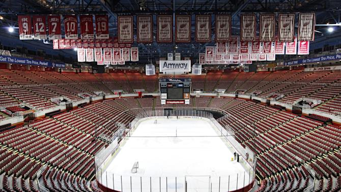 In this photo taken Tuesday, Dec. 18, 2012, championship banners and retired numbers of the Detroit Red Wings hockey team hang from the rafters above the ice at Joe Louis Arena in Detroit. The NHL lockout that's already wiped out the first three months of the season is taking its toll on small businesses in many of the NHL's markets. (AP Photo/Paul Sancya, File)