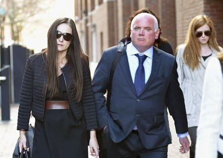 Lorraine, wife of former Anglo Irish Bank CEO David Drumm, walks with her brother-in-law Kenneth after leaving a federal courtroom in Boston