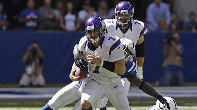 Minnesota Vikings' Christian Ponder (7) is tackled by Indianapolis Colts' Robert Mathis (98) during the first half of an NFL football game in Indianapolis, Sunday, Sept. 16, 2012. (AP Photo/Darron Cummings)
