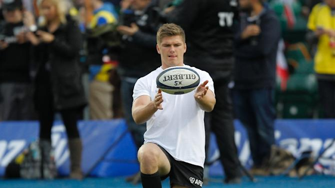Saracens' fly-half from England Owen Farrell warms-up ahead of a rugby match in north London, on October 18, 2014