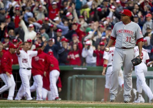 Wild pitch helps Nats beat Reds 3-2 in 10 innings