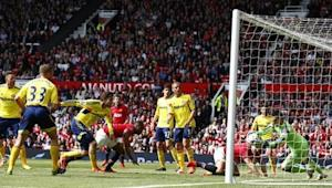 Patrice Evra of Manchester United's header is saved by Sunderland's goal keeper Vito Mannone during their English Premier League soccer match at Old Trafford in Manchester