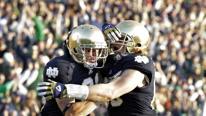 Notre Dame wide receiver John Goodman, left, celebrates with tight end Troy Niklas after scoring a touchdown against Wake Forest during the first half of an NCAA college football game in South Bend, Ind., Saturday, Nov. 17, 2012. (AP Photo/Michael Conroy)