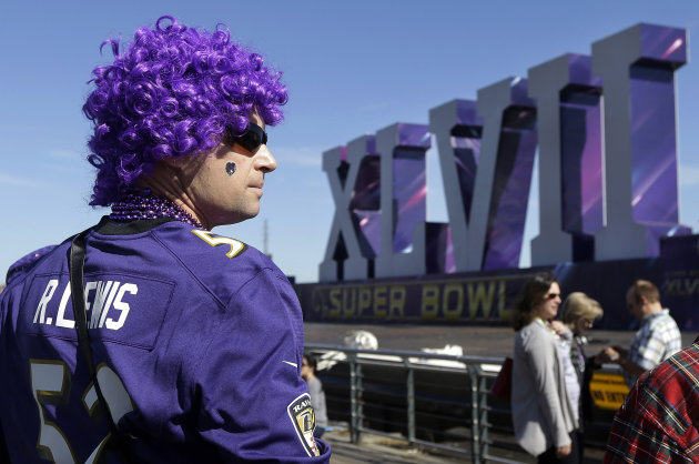 Baltimore Ravens fan Cal Wheaton looks out toward the Super Bowl XLVII sculpture on a barge along the Riverwalk in New Orleans, Sunday, Feb. 3, 2013. The city hosts NFL football's Super Bowl XLVII bet