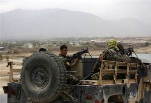 Afghan National Army soldiers keep watch near the site of a gunfight on the outskirts of Kabul