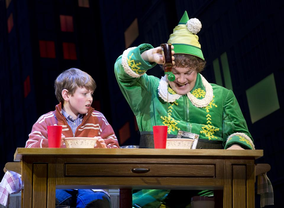"This theater image released by The Hartman Group shows Mitchell Sink, left, and Jordan Gelber during a performance of the musical ""Elf,"" in New York. (AP Photo/The Hartman Group, Joan Marcus)"