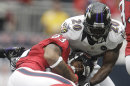 Houston Texans Running Back Arian Foster (23) Is Pulled Down By Baltimore Ravens' Ed Reed (20) During The First Quarter Of An NFL Football Game Sunday, Oct. 21, 2012, In Houston. (AP Photo/Patric Schneider)