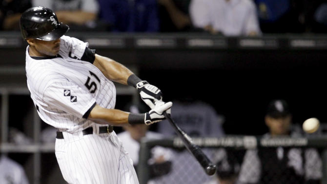 Chicago White Sox's Alex Rios hits a three-run home run off Detroit Tigers starting pitcher Rick Porcello, also scoring Paul Konerko and Dewayne Wise, during the sixth inning of a baseball game, Monday, Sept. 10, 2012, in Chicago. (AP Photo/Charles Rex Arbogast)