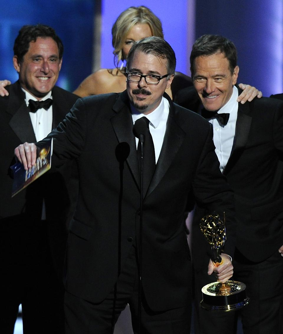 "Vince Gilligan, center, and the cast and crew of ""Breaking Bad"" accept the award for outstanding drama series at the 65th Primetime Emmy Awards at Nokia Theatre on Sunday Sept. 22, 2013, in Los Angeles. (Photo by Chris Pizzello/Invision/AP)"