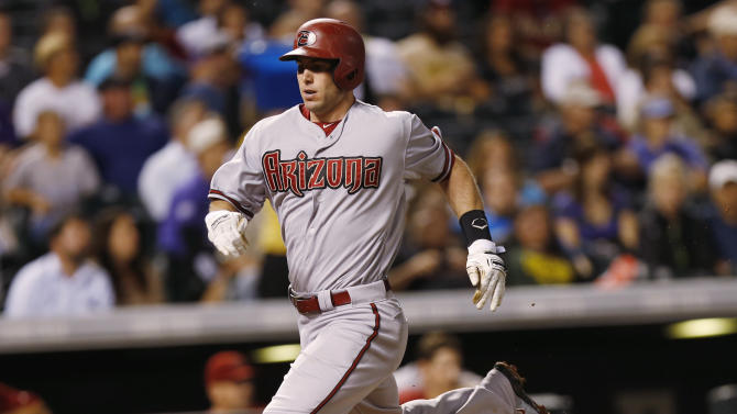 Arizona Diamondbacks' Paul Goldschmidt runs down the third base line to score on a single by David Peralta off Colorado Rockies starting pitcher Chad Bettis in the fifth inning of a baseball game Monday, Aug. 31, 2015, in Denver. (AP Photo/David Zalubowski)