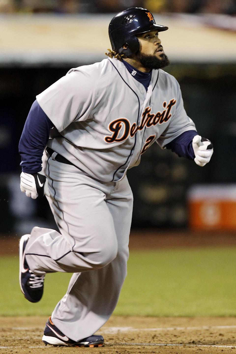 Detroit Tigers' Prince Fielder watches the flight of his solo home run in the fourth inning of Game 4 of their American League division baseball series against the Oakland Athletics in Oakland, Calif., Wednesday, Oct. 10, 2012. (AP Photo/Ben Margot)