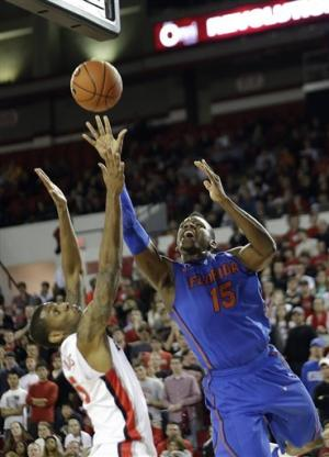 No. 8 Florida starts slow but beats Georgia 64-47