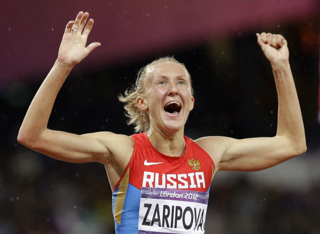 Russia's Yuliya Zaripova celebrates as she wins the women's 3000-meter steeplechase during the athletics in the Olympic Stadium at the 2012 Summer Olympics, London, Monday, Aug. 6, 2012. (AP Photo/Anj
