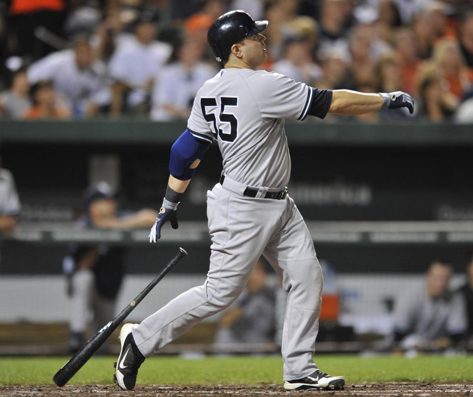 New York Yankees' Russell Martin follows through on a three-run home run against the Baltimore Orioles in the fourth inning of a baseball game Friday, Sept. 7, 2012, in Baltimore. (AP Photo/Gail Burton)