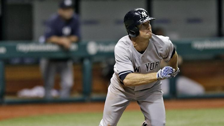 New York Yankees' Brett Gardner follows the flight of his fourth-inning, two- run home run off Tampa Bay Rays starting pitcher Roberto Hernandez during a baseball game, Friday, May 24, 2013, in St. Petersburg, Fla. (AP Photo/Chris O'Meara)