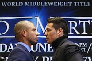 WBC middleweight champion Sergio Martinez of Argentina poses with three-division world champion Miguel Cotto of Puerto Rico during a press conference in New York
