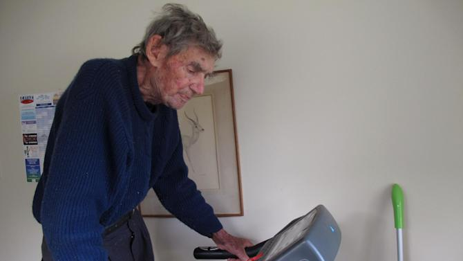 In this Sunday, May 26, 2013 photo, New Zealand's oldest driver Bob Edwards works out on his treadmill at his home in Ngataki, New Zealand. Edwards, 105 yeas-old, got his first license 88 years ago and has no plans to stop driving, just as he intends to keep working out every morning in his home gym. (AP Photo/Nick Perry)
