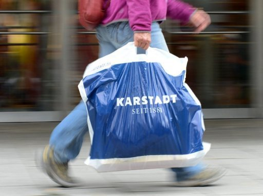 <p>A customer carries a bag with the logo of German retail chain Karstadt in Munich, southern Germany. With a string of high-profile bankruptcies and thousands of layoffs, the German retail sector is in upheaval as it struggles with the challenges of changing customer trends and online shopping</p>