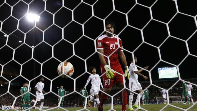 Iraq's goalkeeper Mohammed Hameed Farhan reacts as UAE's Ali Mabkhout scores the winning goal from a penalty kick past during their Asian Cup third-place playoff soccer match at the Newcastle Stadium in Newcastle