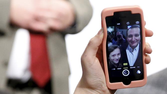 A girl takes a selfie with Cruz after his rally at Morningstar Fellowship Church in Fort Mill, South Carolina