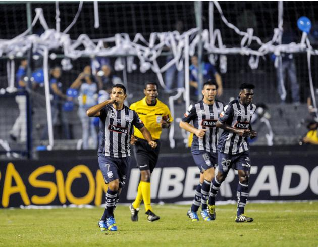 Ecuador's CS Emelec player Escalada celebrates with teamates Stracqualursi and Lastra after scoring against Mexico's Leon FC during their second leg match of the Copa Libertadores in Guayaquil