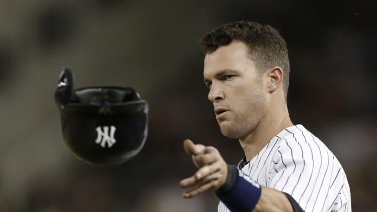 New York Yankees' Jayson Nix tosses his helmet after hitting into a sixth-inning double play with the bases loaded in a baseball game against the Texas Rangers, Wednesday, June 26, 2013, in New York. (AP Photo/Kathy Willens)