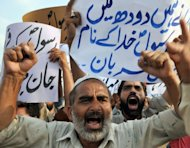 <p>Pakistani Muslims shout anti-US slogans during a protest rally against an anti-Islam movie in Islamabad on September 15. Washington said it was deploying forces to cope with violence in as many as 18 different locations as deadly Muslim anger spreads over a US-made movie that mocks Islam.</p>