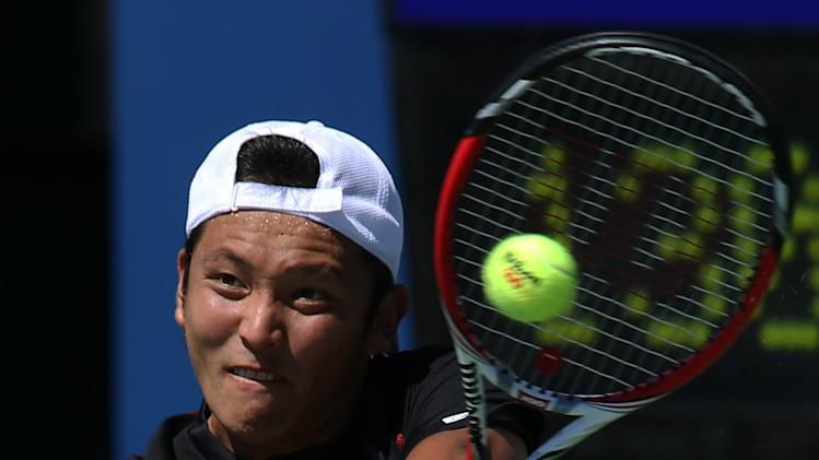 Tatsuma Ito, of Japan, returns a shot against Feliciano Lopez, of Spain, during the second round of the 2014 U.S. Open tennis tournament, Friday, Aug. 29, 2014, in New York. (AP Photo/John Minchillo)