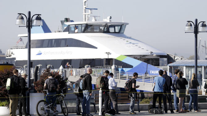 Commuters wait to board a ferry bound for San Francisco on Friday, Oct. 18, 2013, in Oakland, Calif. Commuters in the San Francisco Bay Area got up before dawn on Friday and endured heavy traffic on roadways, as workers for the region's largest transit system walked off the job for the second time in four months.(AP Photo/Marcio Jose Sanchez)