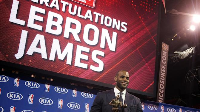 Miami Heat's LeBron James poses for photos during an NBA basketball news conference, Sunday, May, 5, 2013, in Miami. James was formally announced as having won his fourth Most Valuable Player award Sunday. (AP Photo/J Pat Carter)