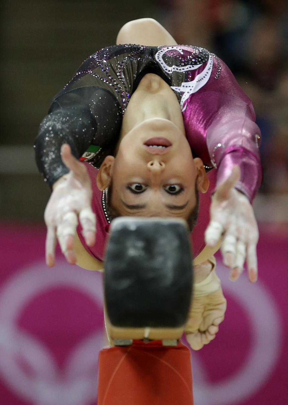 Mexican gymnast Elsa Garcia Rodriguez Blancas performs on the balance beam during the Artistic Gymnastics women's qualification at the 2012 Summer Olympics, Sunday, July 29, 2012, in London. (AP Photo/Gregory Bull)