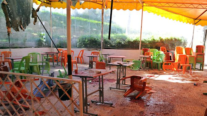 In this photo released by the Syrian official news agency SANA, plastic tables and chairs turned upside down, are seen on the floor of the open-air cafeteria at Damascus University in the central Baramkeh district, in Damascus, Syria, Thursday, March 28, 2013. Mortar shells slammed into a cafeteria at Damascus University, killing several people and wounding scores, according to state media and an official. It was the deadliest in a string of such attacks on President Bashar Assad's seat of power, state media and an official said. (AP Photo/SANA)