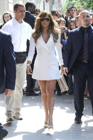 Jennifer Lopez hits the cobbled streets of Paris in a chic white trench dress