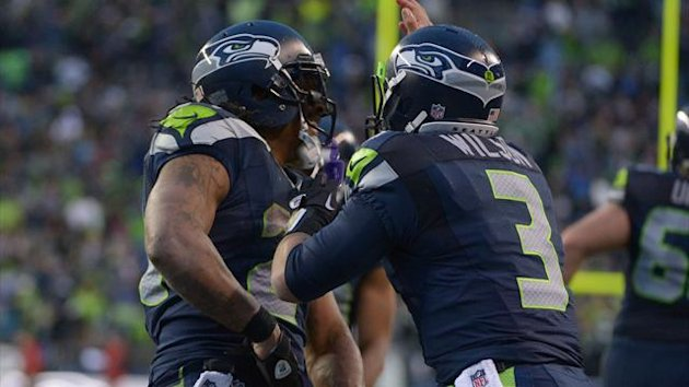 Seattle Seahawks running back Marshawn Lynch (left) celebrates with quarterback Russell Wilson