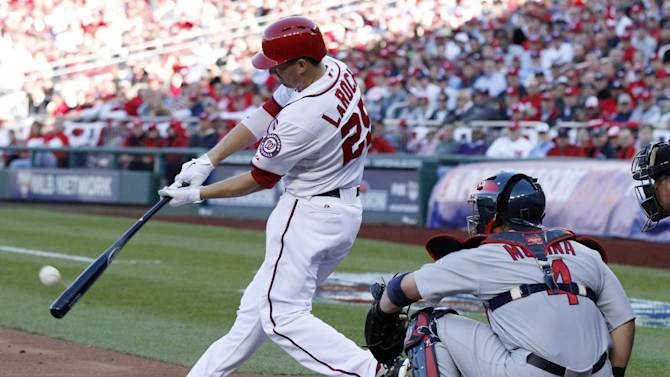 Washington Nationals' Adam LaRoche hits a solo home run in the second inning of Game 4 of the National League division baseball series against the St. Louis Cardinals on Thursday, Oct. 11, 2012, in Washington. (AP Photo/Mark Tenally)