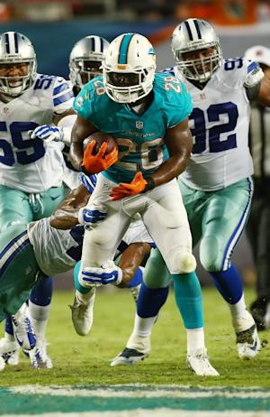 Dolphins rally past Cowboys, 25-20