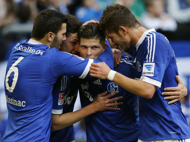 Schalke's Klaas-Jan Huntelaar of the Netherlands , second from right, celebrates with teammates after scoring  during the German first division Bundesliga soccer match between Schalke 04 and 1899