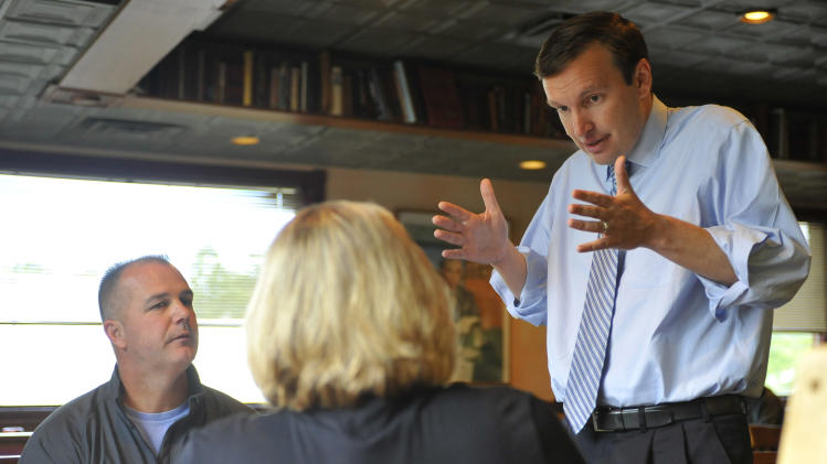 In this Wednesday, Sept. 19, 2012 photo, Democratic candidate for U.S. Senate Chris Murphy, right, talks with Chris Sudock, left, and Laura Sudock, center at a diner in Meriden, Conn. Wealthy former pro wrestling executive Linda McMahon is shifting her image from groin-kicking CEO to grandmother in her second bid for a Senate seat from Connecticut. Polls show the strategy seems to be working against three-term Democratic congressman Murphy. (AP Photo/Jessica Hill)