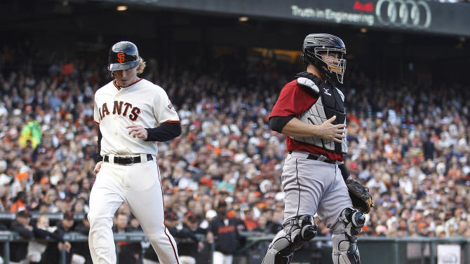 San Francisco Giants' Mike Fontenot, left, scores past Houston Astros catcher Humberto Quintero on a Carlos Beltran grounder during the first inning of a baseball game in San Francisco, Saturday, Aug. 27, 2011. (AP Photo/Tony Avelar)