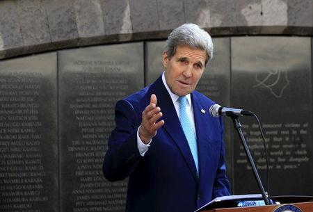 U.S. Secretary of State Kerry addresses at the memorial park where the  former U.S. embassy premises stood after laying a wreath in memory of those killed during a car bomb blast in August 1998, in Nairobi
